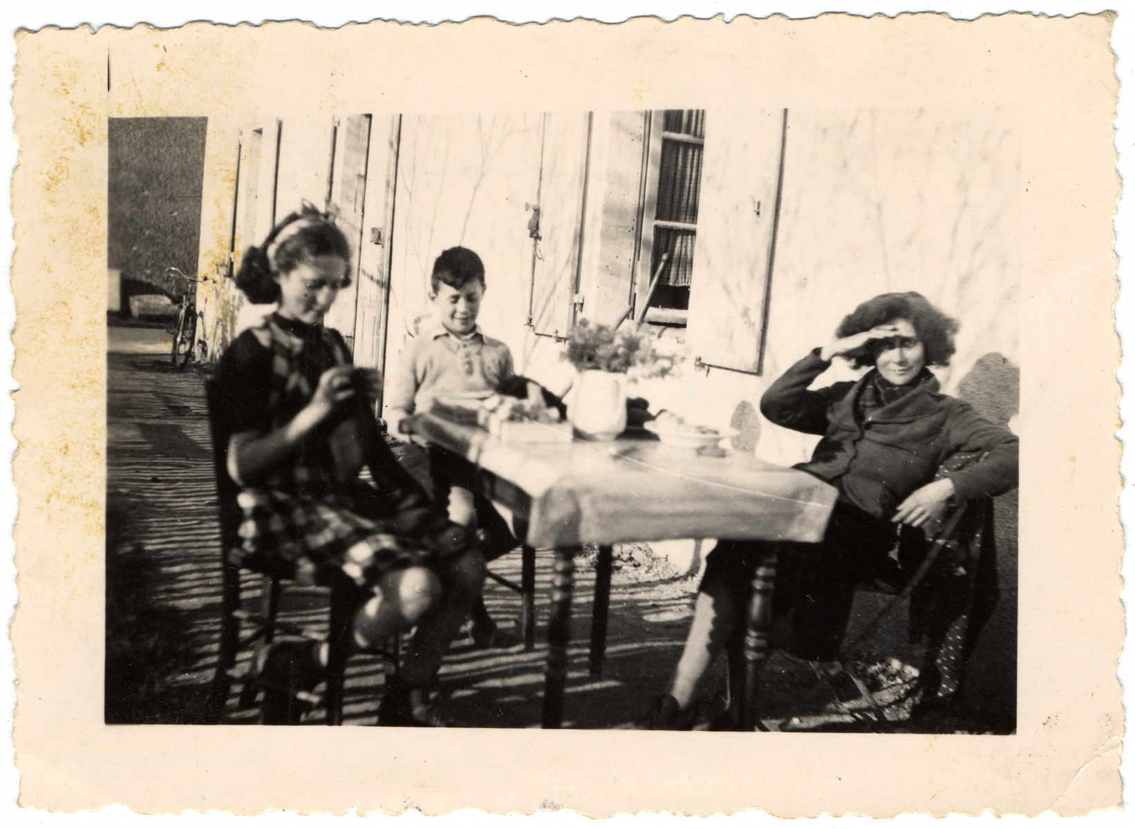 Portrait of the Meyer family sitting at an outdoor table in Chasseneuil, Vienne, France.