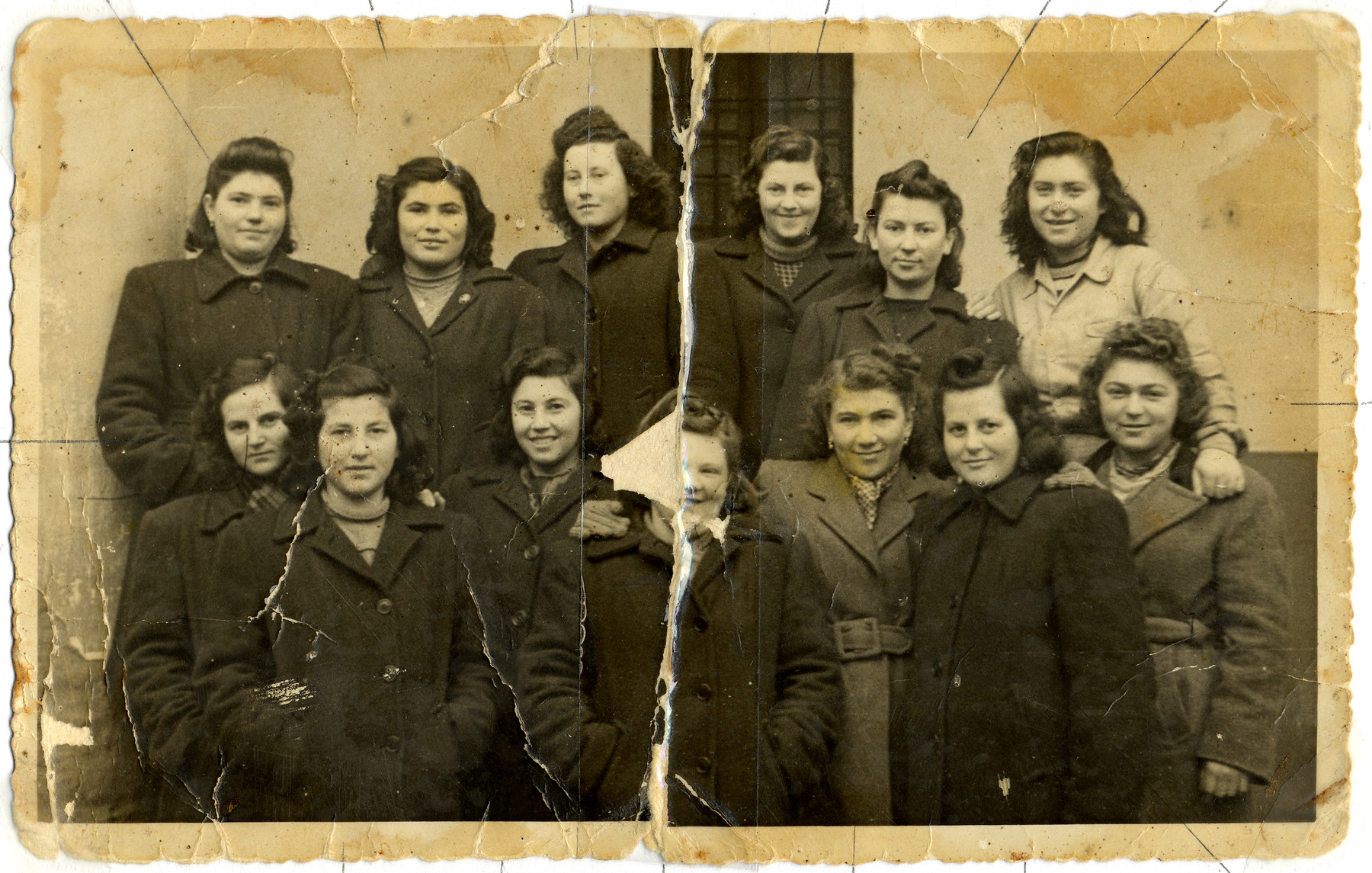 Group portrait of young women from the Kibbutz Mekor Baruch hachshara in Bacoli, Italy.    Pictured from left to right: (front row) Miriam Gutman, Malka Gutman, Chaya (Evi) Weiss, Mali Deutsch, unknown, Haviva Gutman, Pola.  (second row) Tzipora (Ibi) Weiss, Rozsi Gutman, Bertha Gutman, Rivke Gutman, unkown and Giza Sorkis.