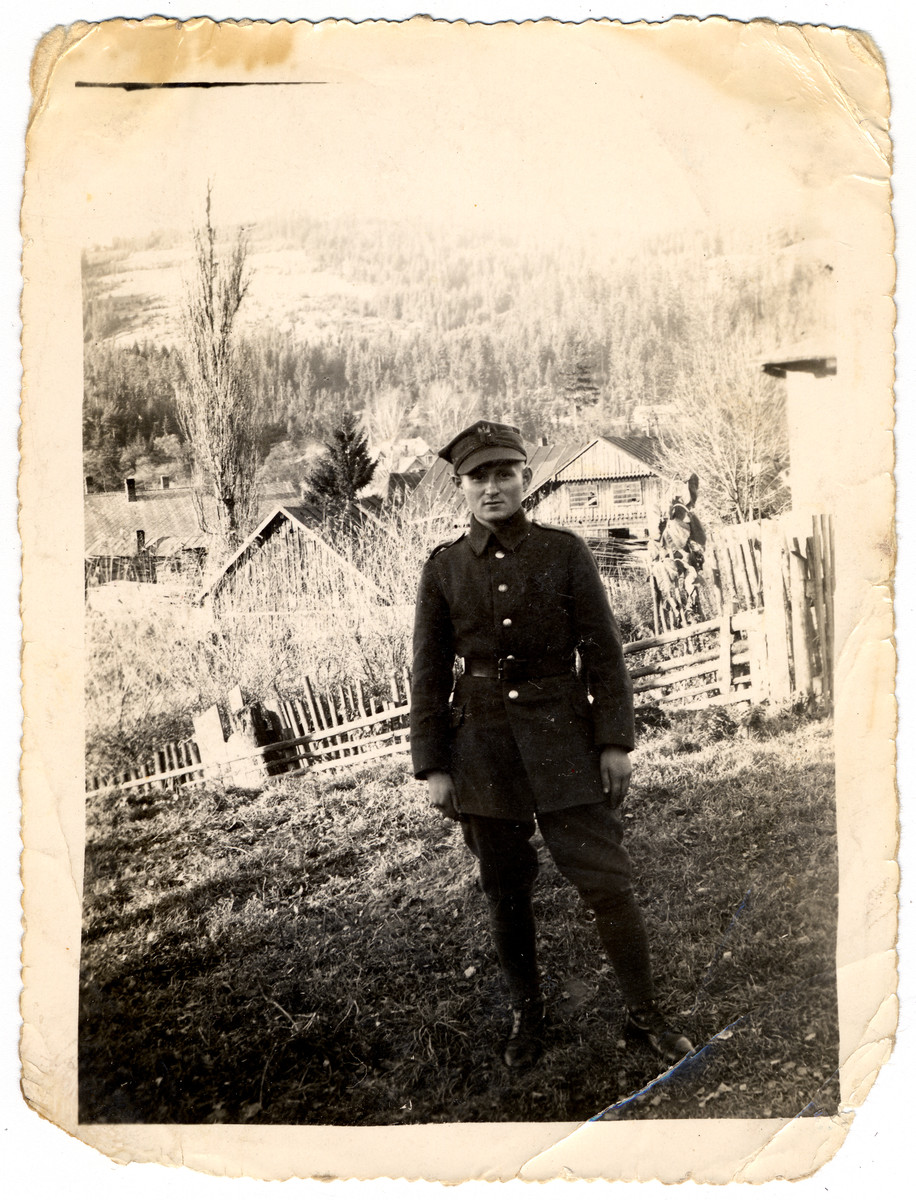 Abraham Samoszul stands outside in his Polish uniform.  He was born in 1916 and killed in Treblinka at the age of 26.