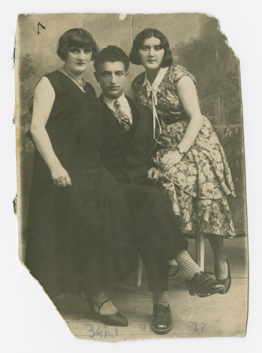 Gita (left) and Mendel Kuperman pose with Rivka Rubinzon, Gita's sister, for a portrait.