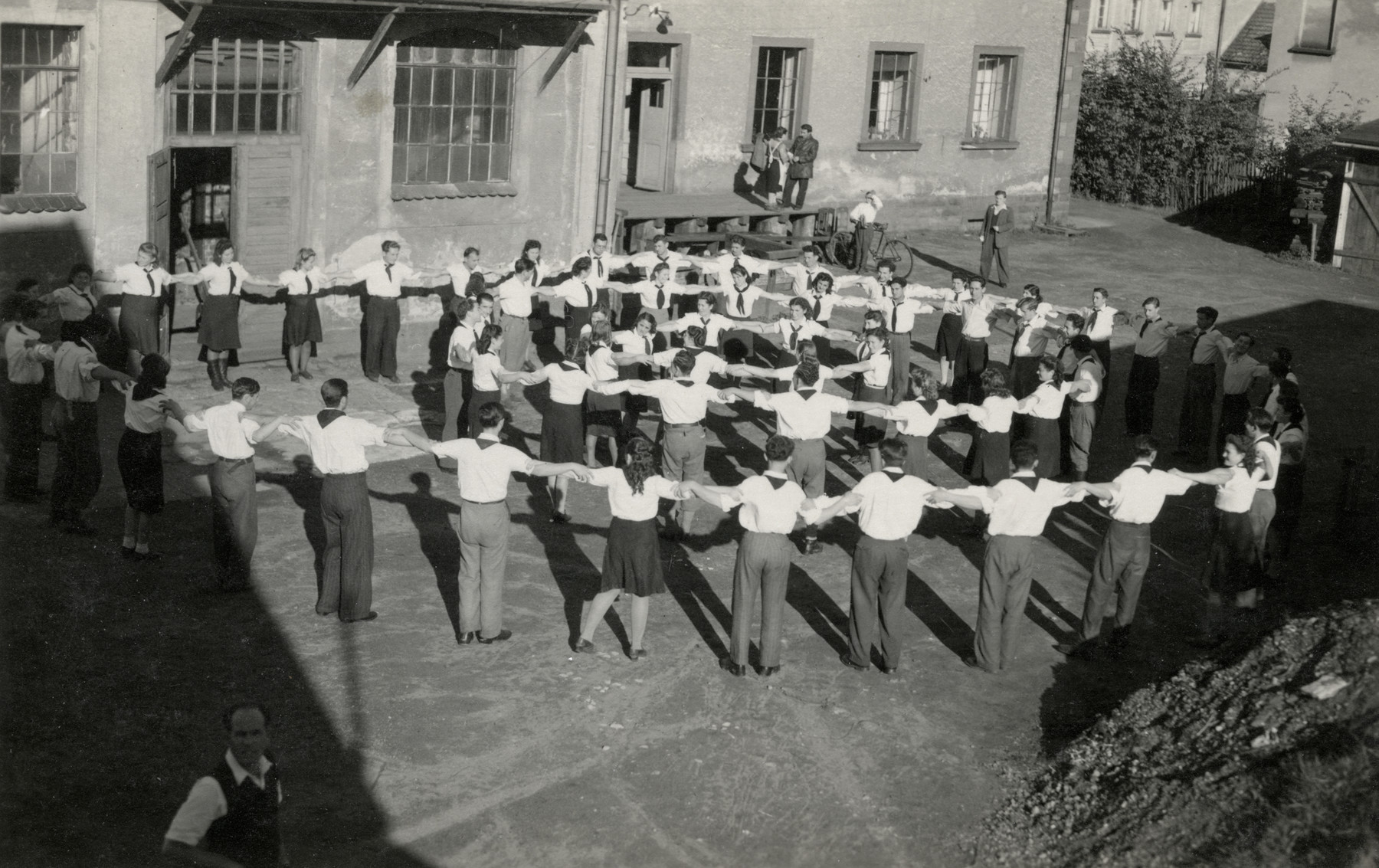 Zionist youth dance a hora in the Ludwikowo children's home.