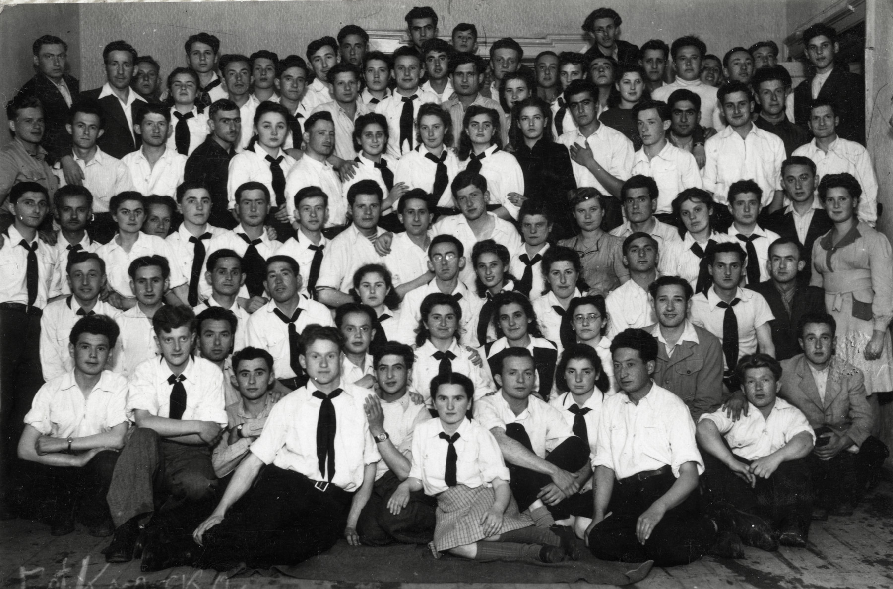 Group portrait of Zionist youth in a kibbutz in Lodz.    Ita Shapiro is pictured in the front row, 3rd from the right.
