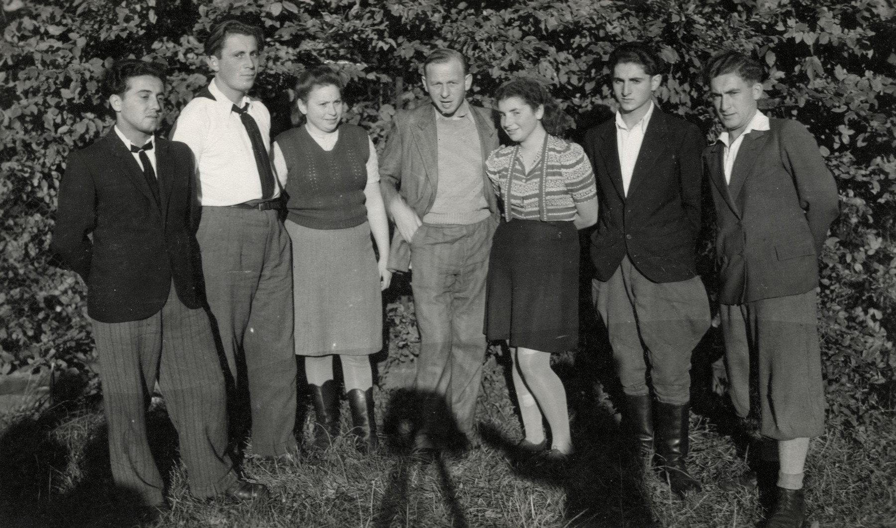 Group of young adults, [perhaps at the Chantilly children's home.]  Ita Shapiro is in the striped sweater with Zalman, the representative from Israel.