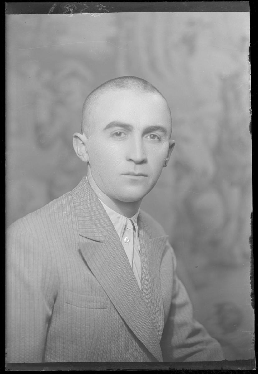 Studio portrait of Herman Smilovits.