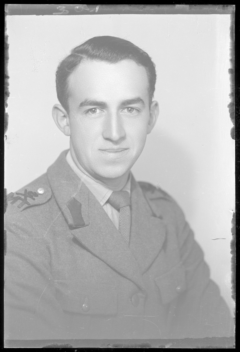 Studio portrait of Tibor Rozenberg, in uniform.