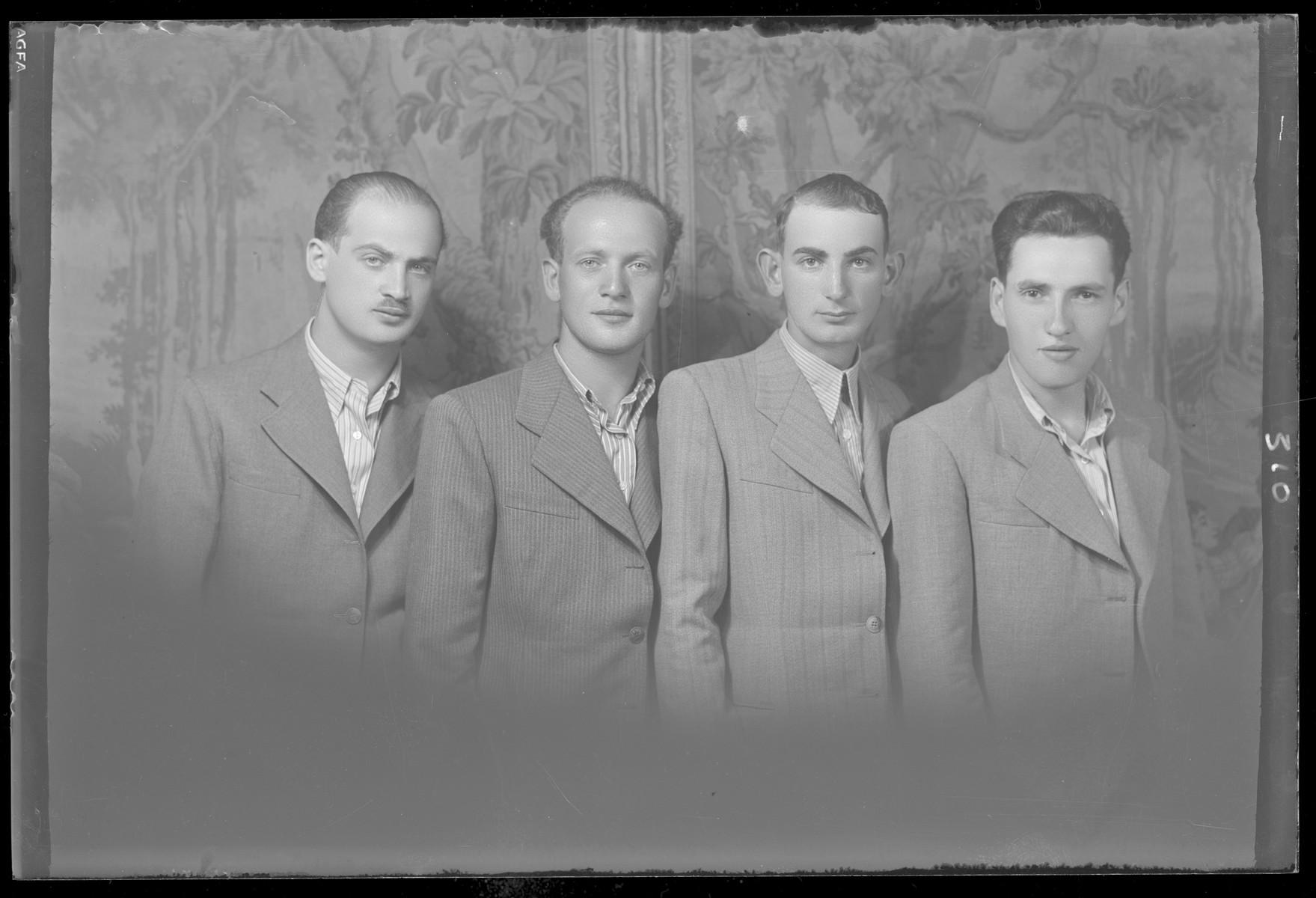 Studio portrait of Zoltan Schvartz and three other men.