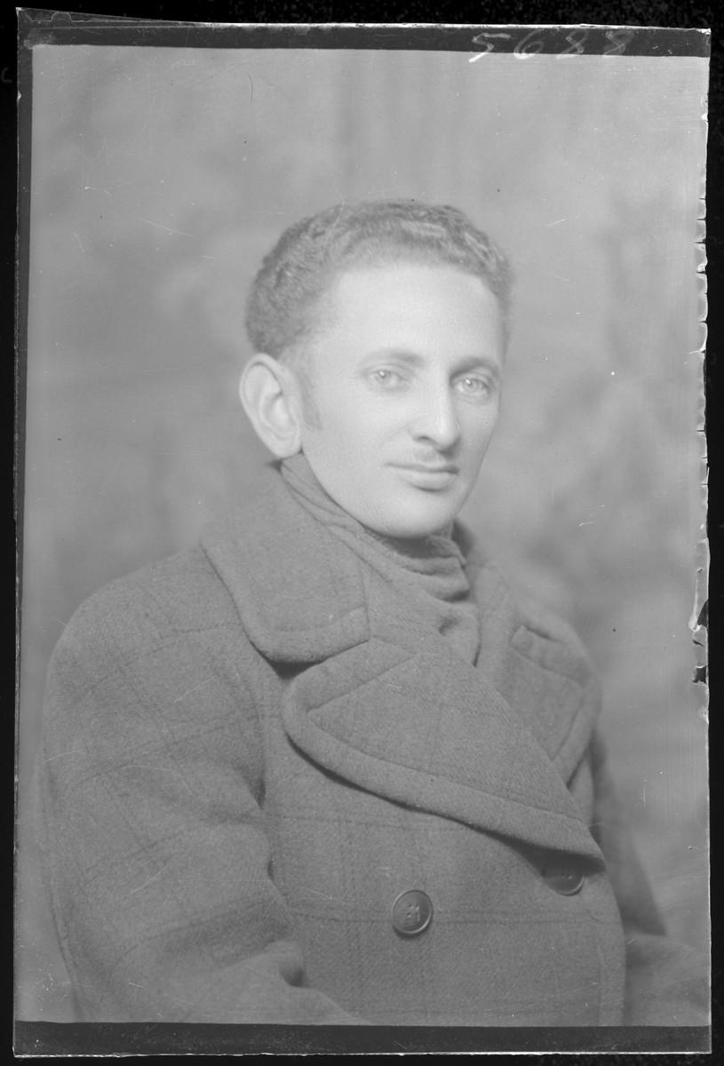 Studio portrait of Laszlo Schalamon.
