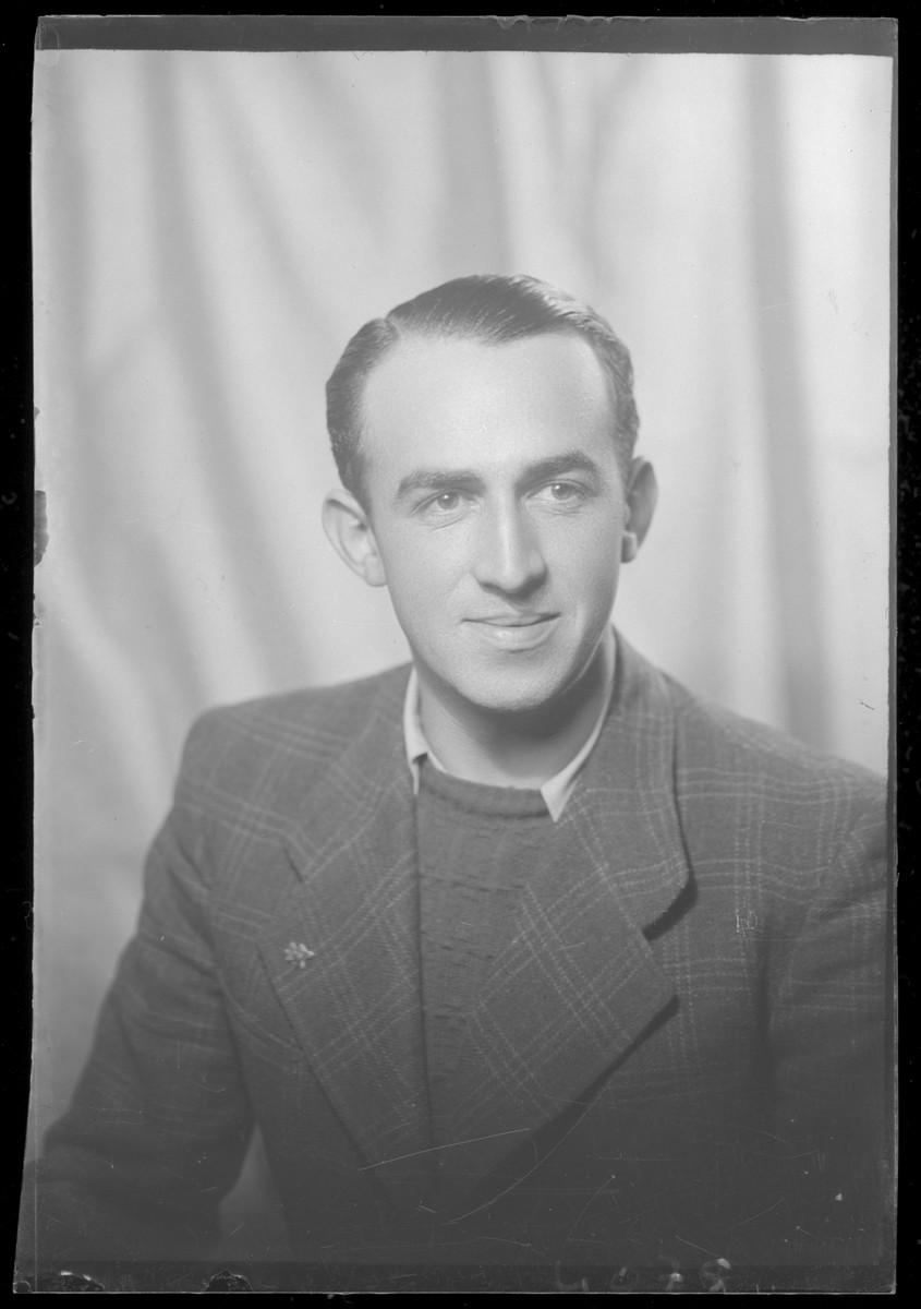 Studio portrait of Tibor Rozenberg.