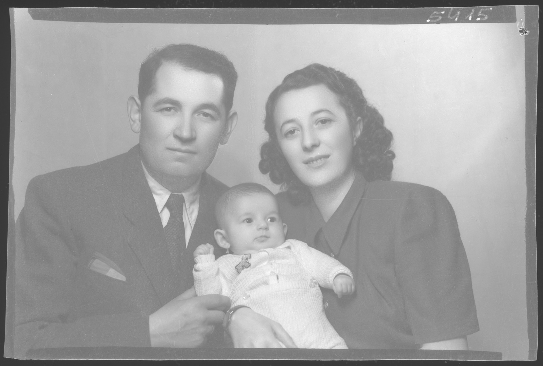 Studio portrait of Anton (Ancsi) Rosenfeld, his wife Gizella Melchner Rosenfeld, and their daughter Vera.  Gizella and Anton met after the war and married in 1946.  Gizella survived Auschwitz and Anton was in a labor battalion.