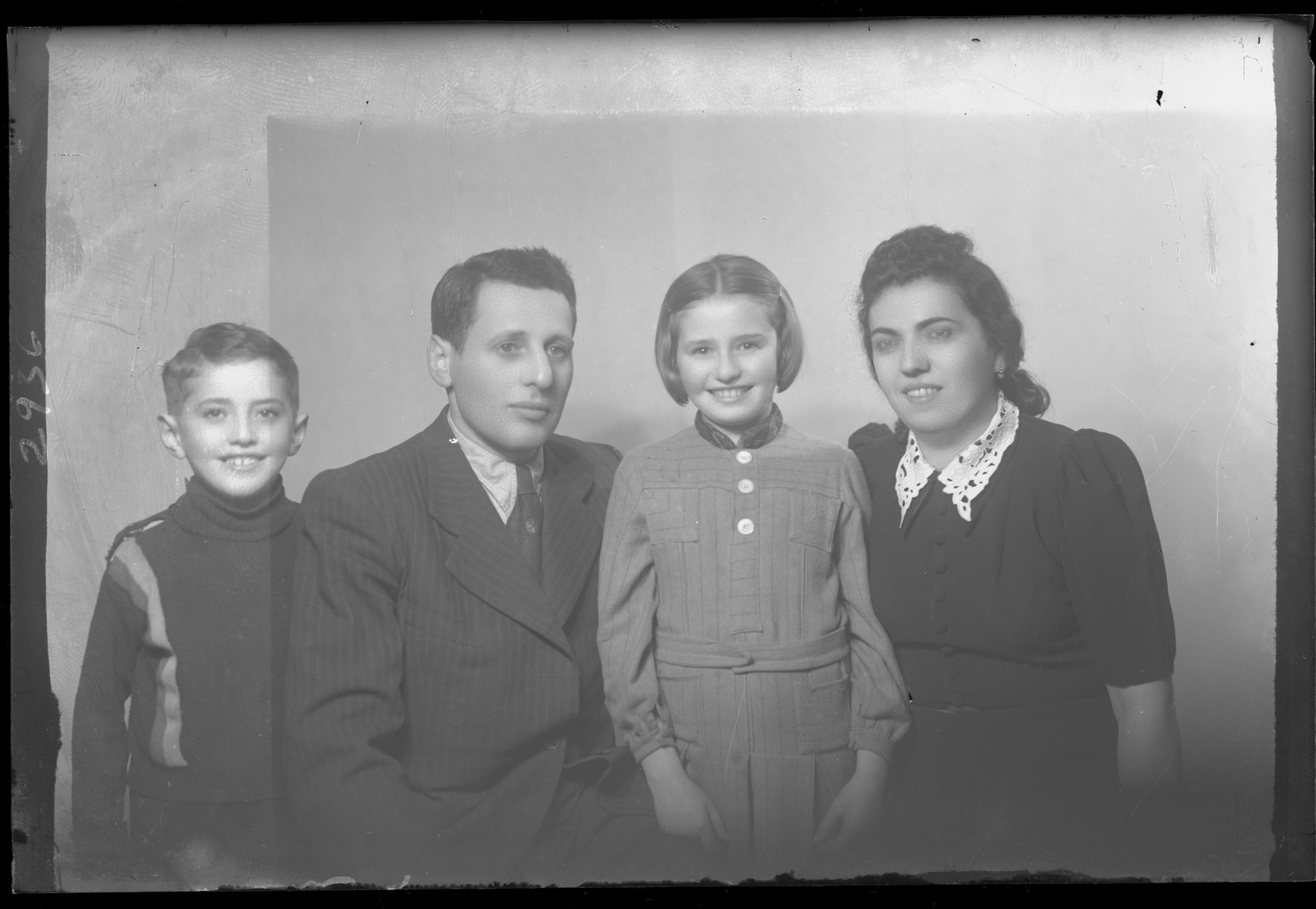 Studio portrait of the family of Gyorey Schartz.