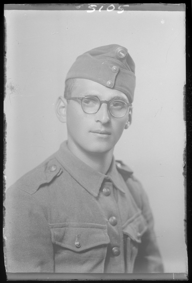 Studio portrait of Abraham Rozenfeld in military uniform.