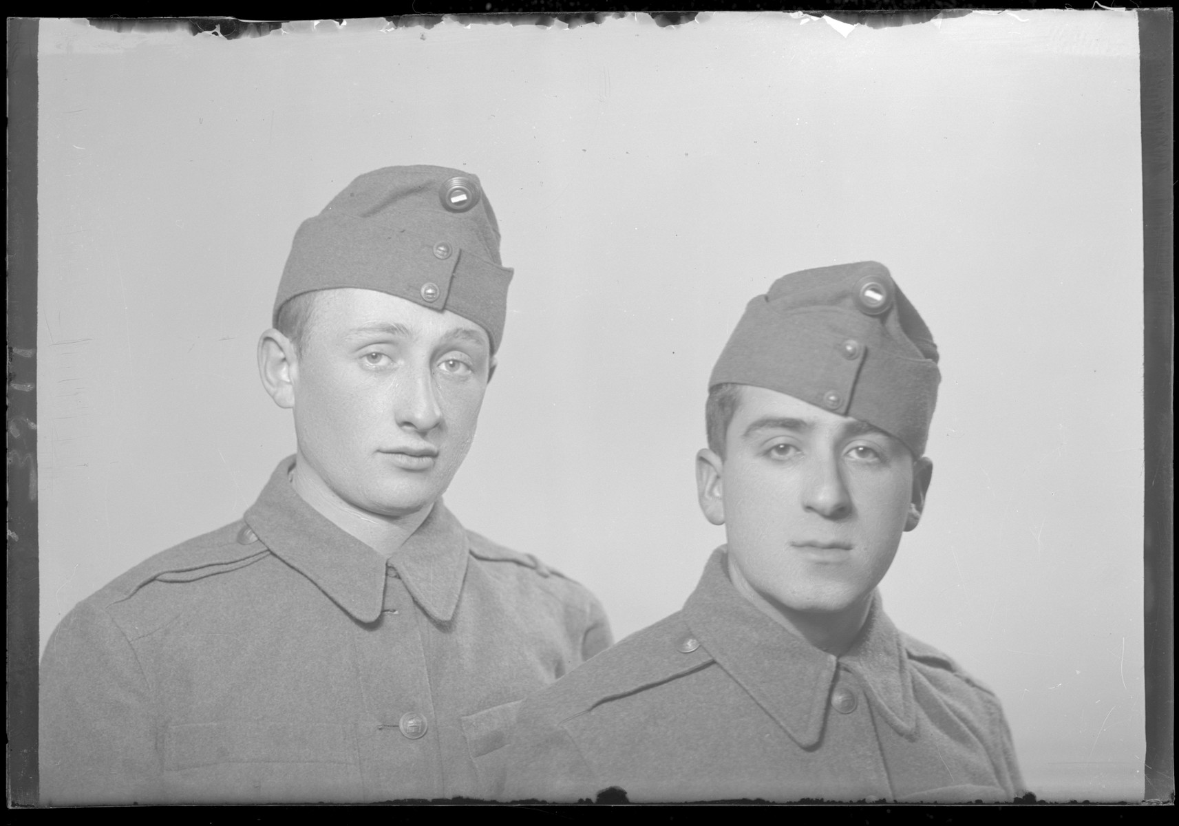 Studio portrait of Erno Silberstein and another man, both in military uniform.