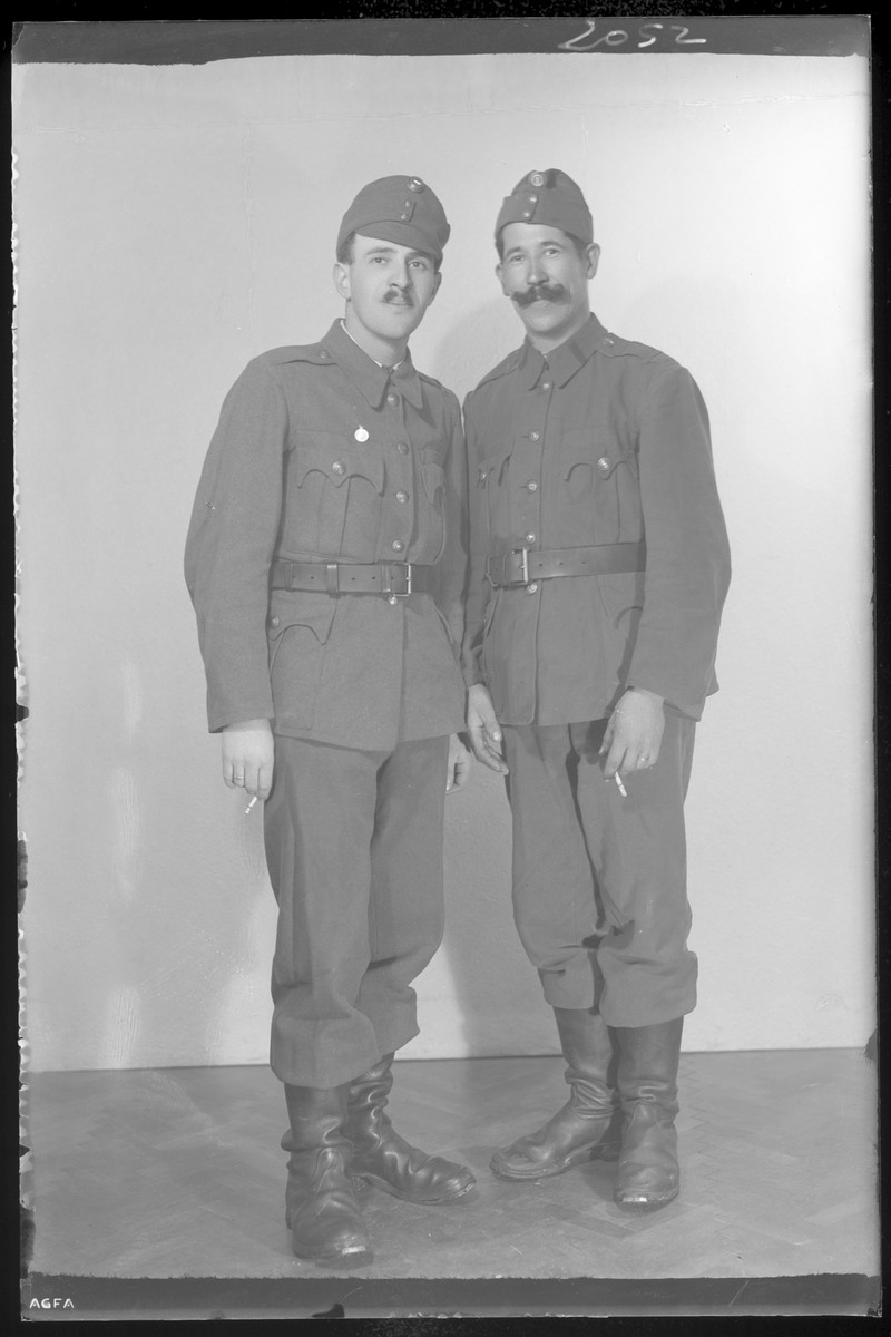 Studio portrait of Sica Salamon and another man, both in military uniform.