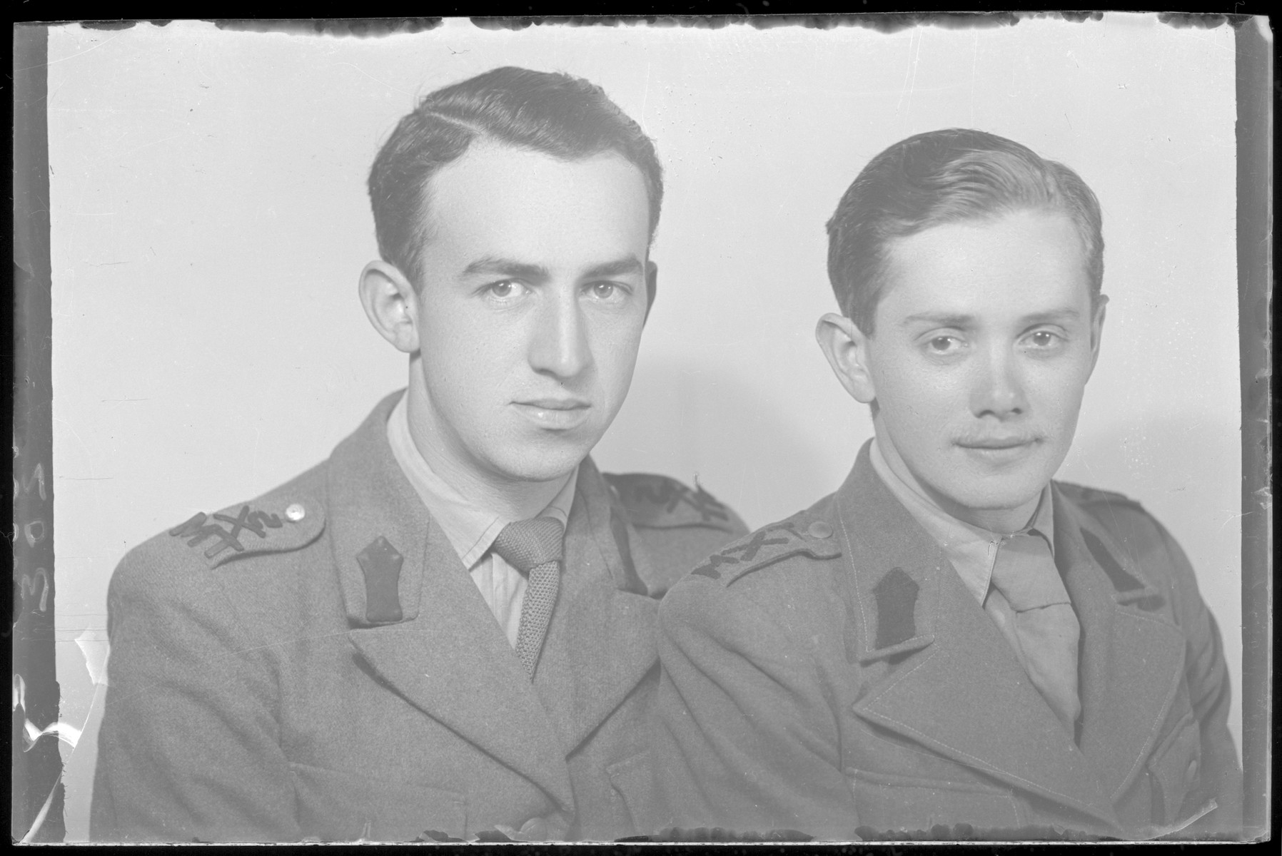 Studio portrait of Tibor Rozenberg and another man, both in uniform.