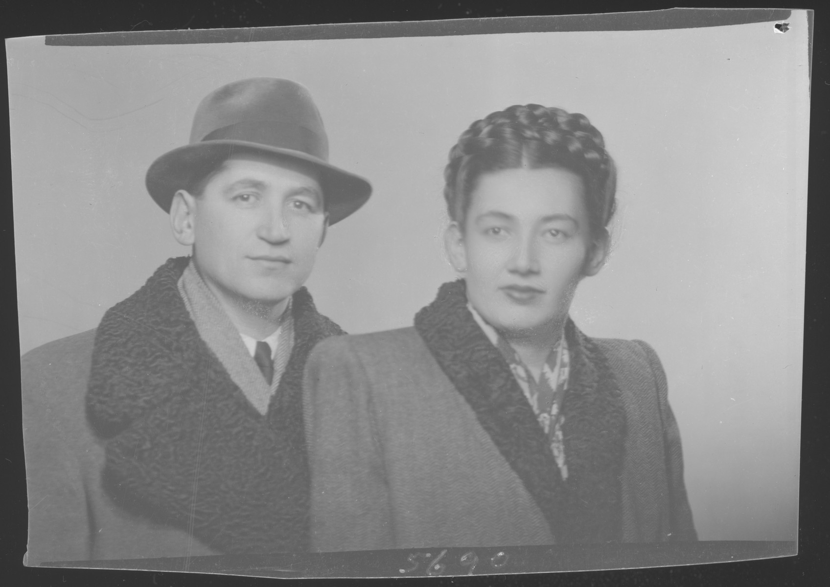 Studio portrait of  Matei Rosenfeld and wife, Lili (Kaufman) Rosenfeld. They able to immigrate to Sydney, Australia.