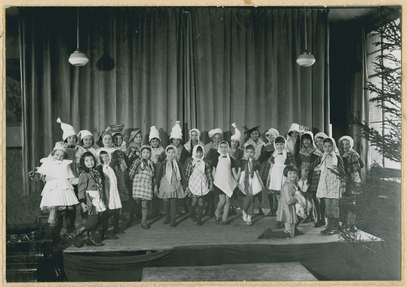 Girls in a French elementary school perform a Christmas pageant.  Lucie Zonendlich is pictured in the first tow on the left.