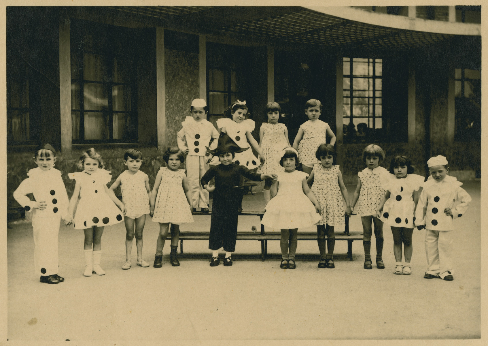 Girls from the elementary school rue Egene Reisz perform in costume.  Lucie Zonendlich is pictured second from the right in the first row.
