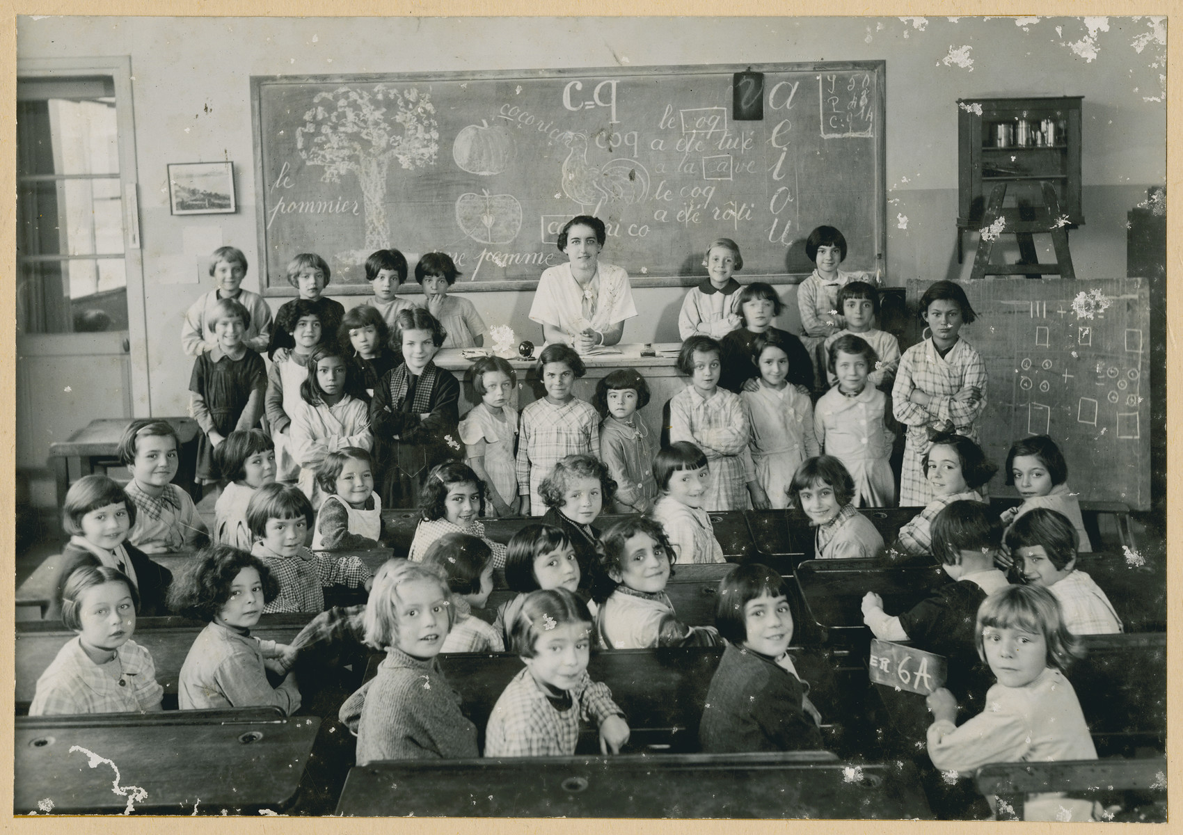 Class picture inside a girls classroom in the school on the rue Eugene Reisz.   Lucie Zonendlich is pictured in the third row, third from the left.