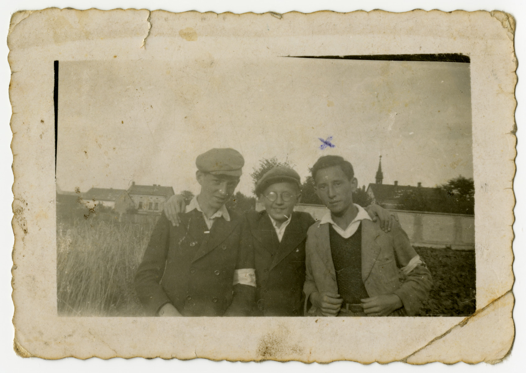 Portrait of three Jewish youth in the Sosnowiec ghetto.