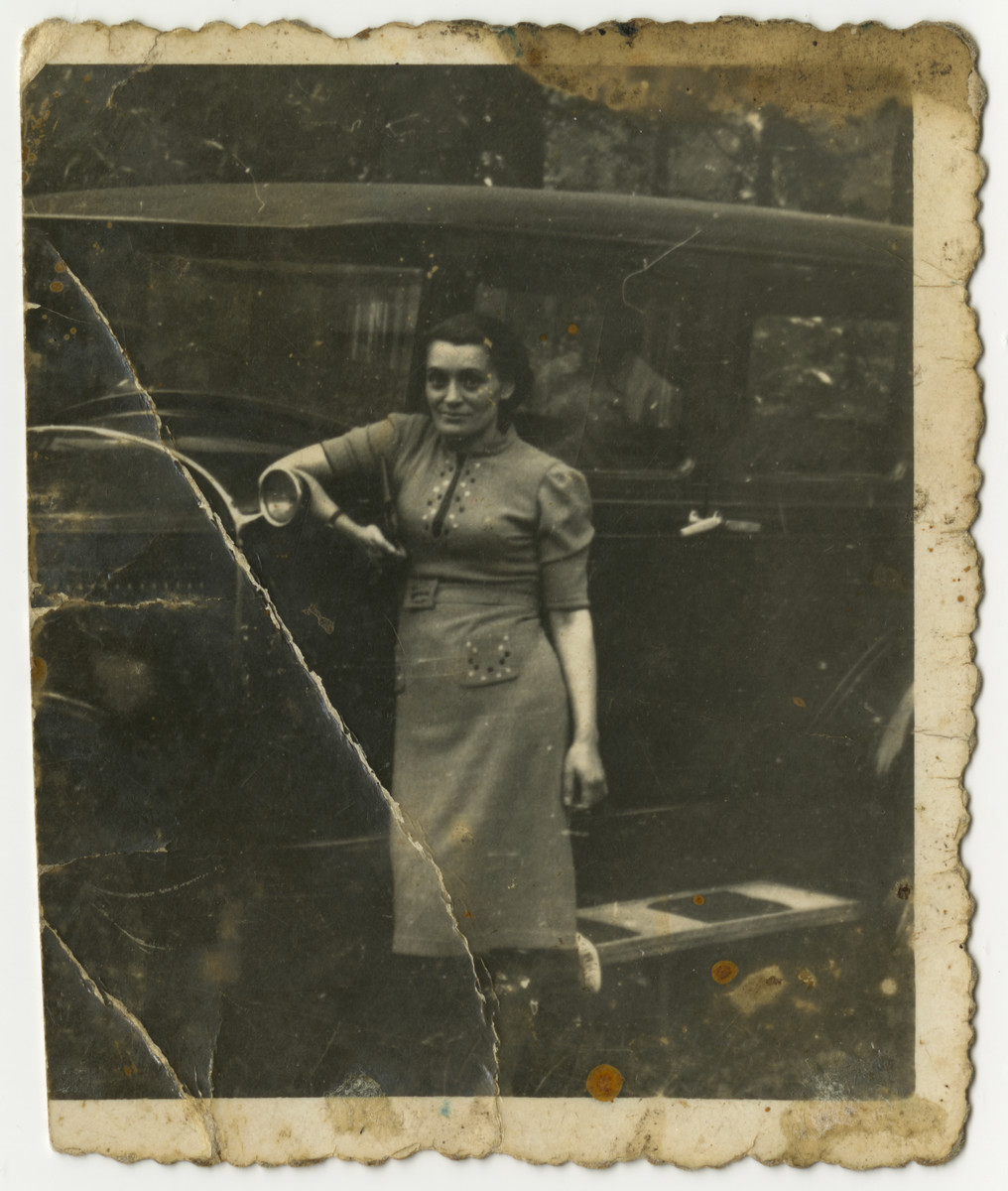 """Prewar portrait of Mania (last name unknown) leaning against an automobile and given to Fela Zyndorf in the Bobrek concentration camp.  The original caption reads: """"As a show of friendship to my camp friend -- Mania."""""""