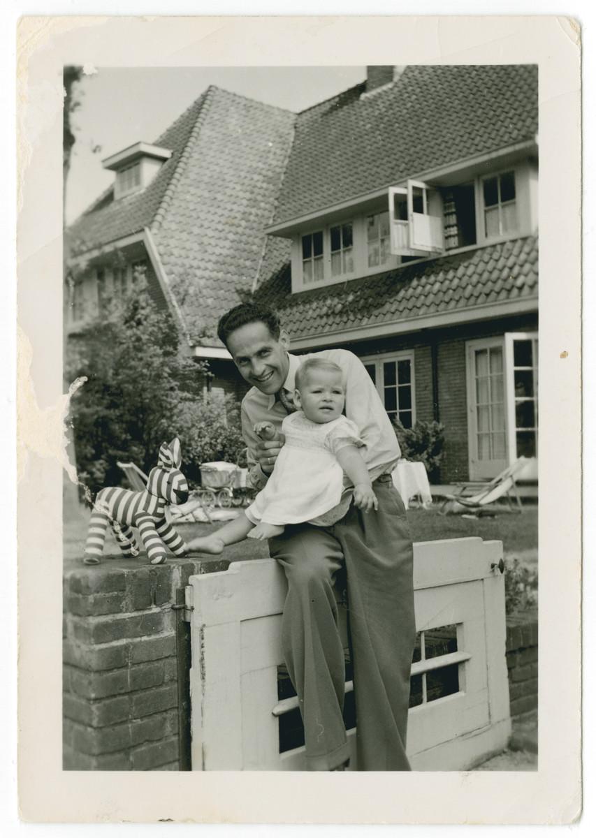 Harry Straus poses with his newborn daughter Hetty.