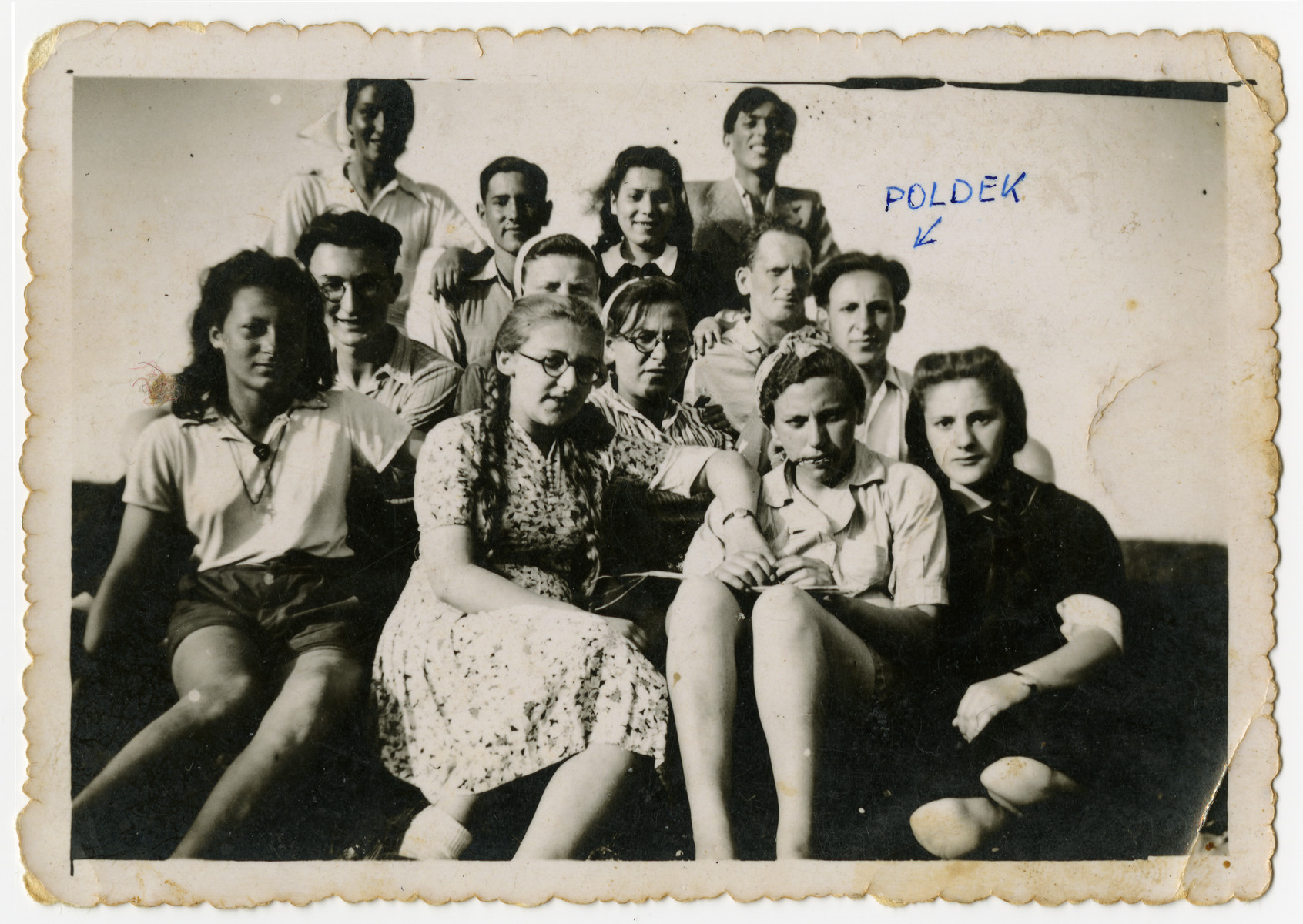 "Group portrait of Zionist youth in ""Farma.""  The ""Farma"" was a plot of land between Bedzin and Sosnowiec that was allocated to the local Zionist youth movements by the Jewish Council for the growing of vegetables. The youth movements created a hachshara on the site. Soon after, the ""Farma"" became the center of resistance efforts, as well as youth activity, in the ghetto."