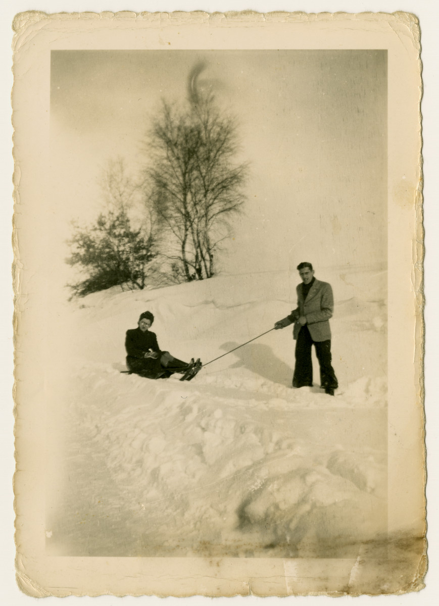 Dini and Harry Straus go sledding about two years before going into hiding.