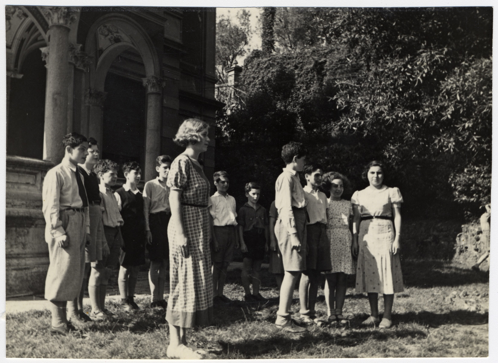 Students at the Mediterranean School in Recco, Italy line up outside on the grounds of the school.