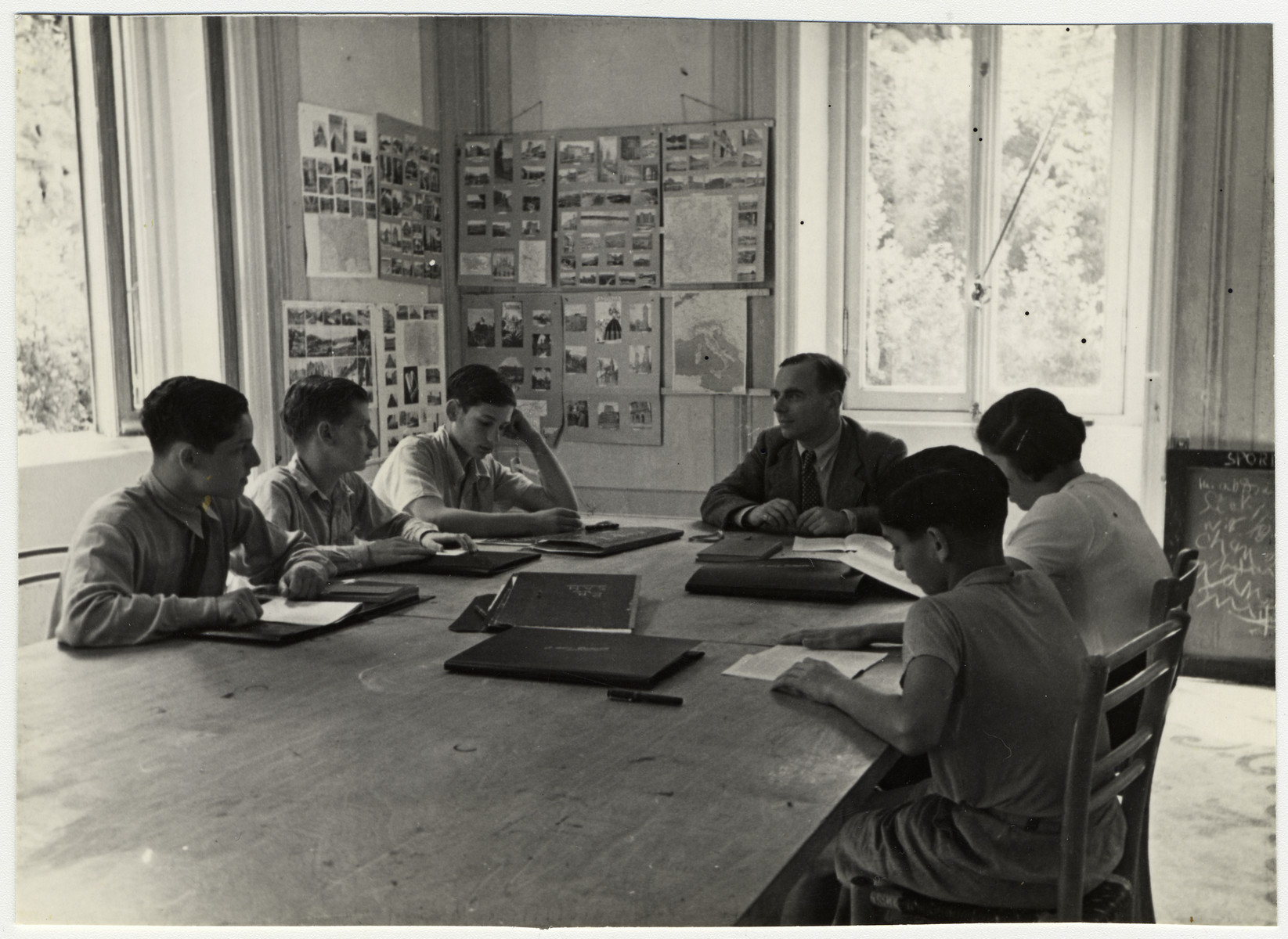 Older students study in a classroom decorated with photographs and posters in the Mediterranean School in Recco, Italy.