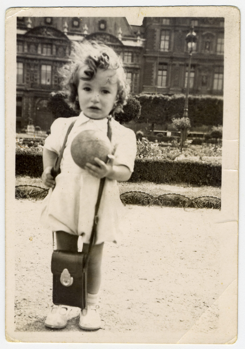 Marcel Hodak poses in a park in Paris holding a ball.