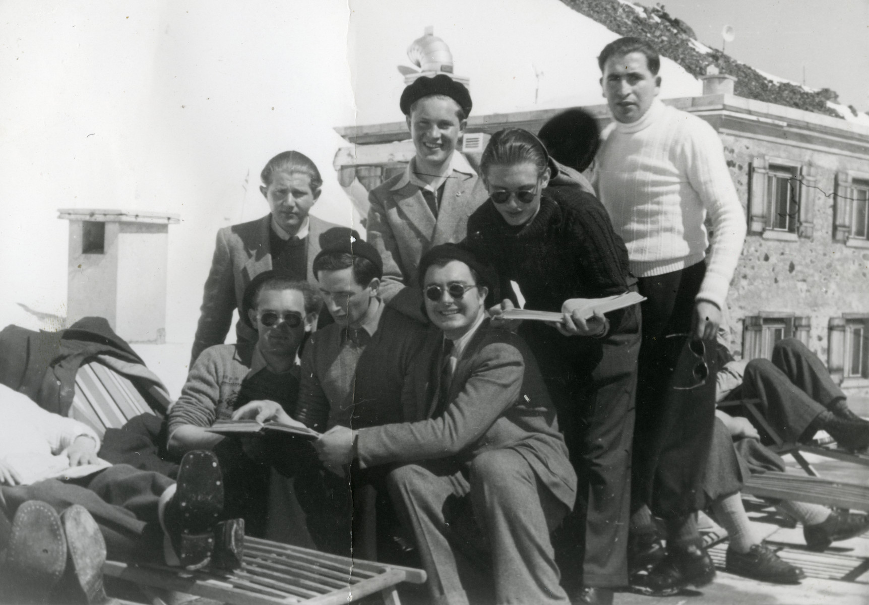 Jewish displaced persons recover in a sanatorium in Davos after the war.  Zvi Grundman is pictured in the front center reading a book.