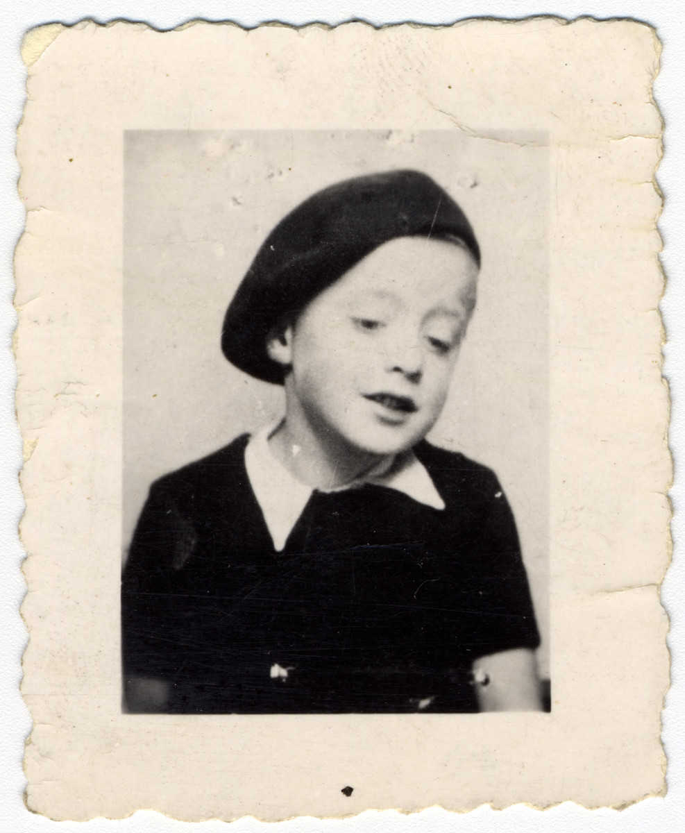 Close-up portrait of Jacques Rovinski taken shortly before he was deported and killed at the age of seven.  He was captured in the Voiron round-up, one of the last to take place in France.