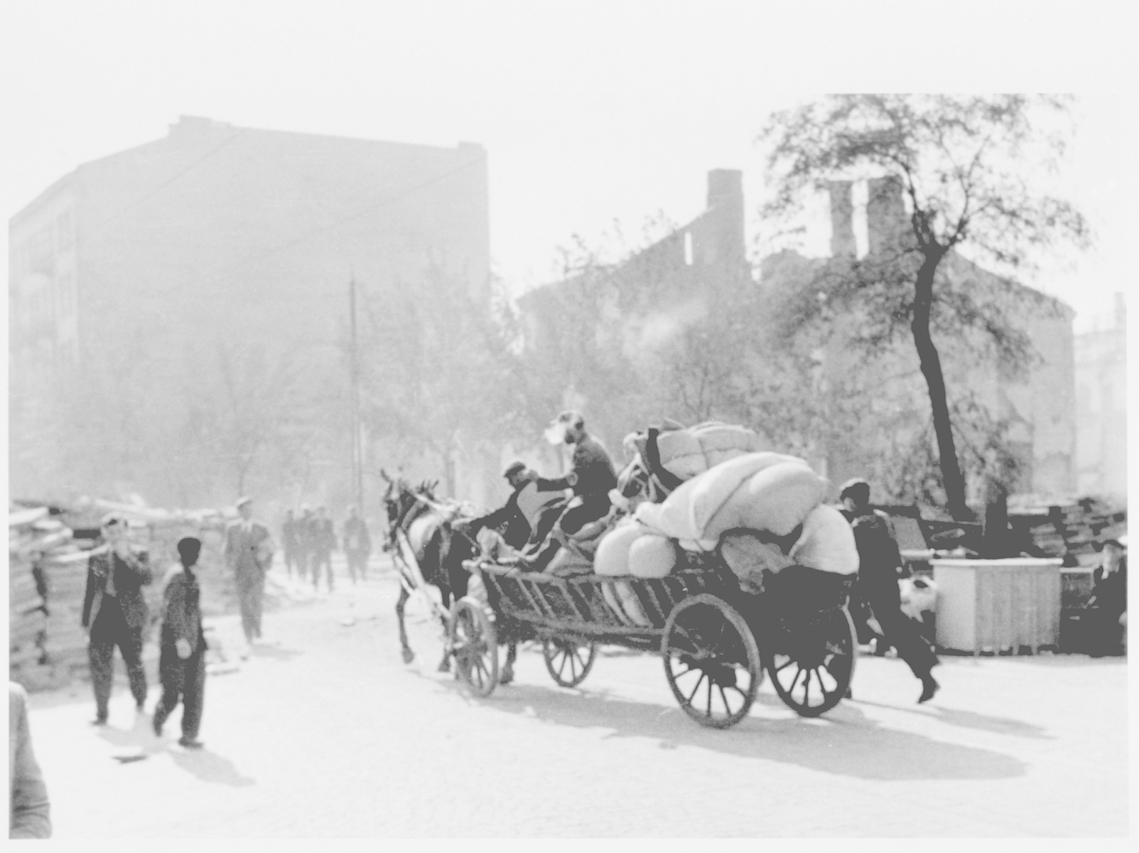 Polish refugees leave Warsaw on a horse-drawn wagon loaded with their personal property during the German siege of the capital.