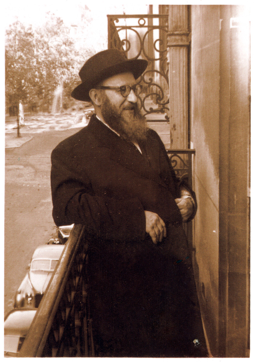 Rabbi Zalman Schneerson, leader of Orthodox Jewry in France, stands outside on a balcony.