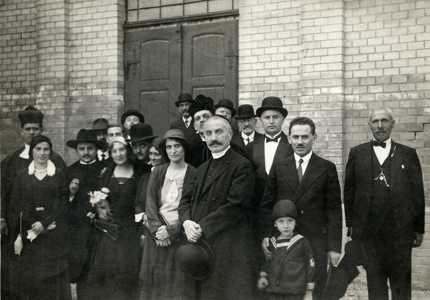 The Frenkel family celebrates the graduation of Rabbi Erne Frenkel, the Rabbi of Bicske.   Pictured are Jeno Frenkel (left corner), Edit Frenkel (holding flowers), Margit Weiss (an aunt of the donor, standing next to her), the donor's grandmother in the back, and Rabbi Erne Frenkel.