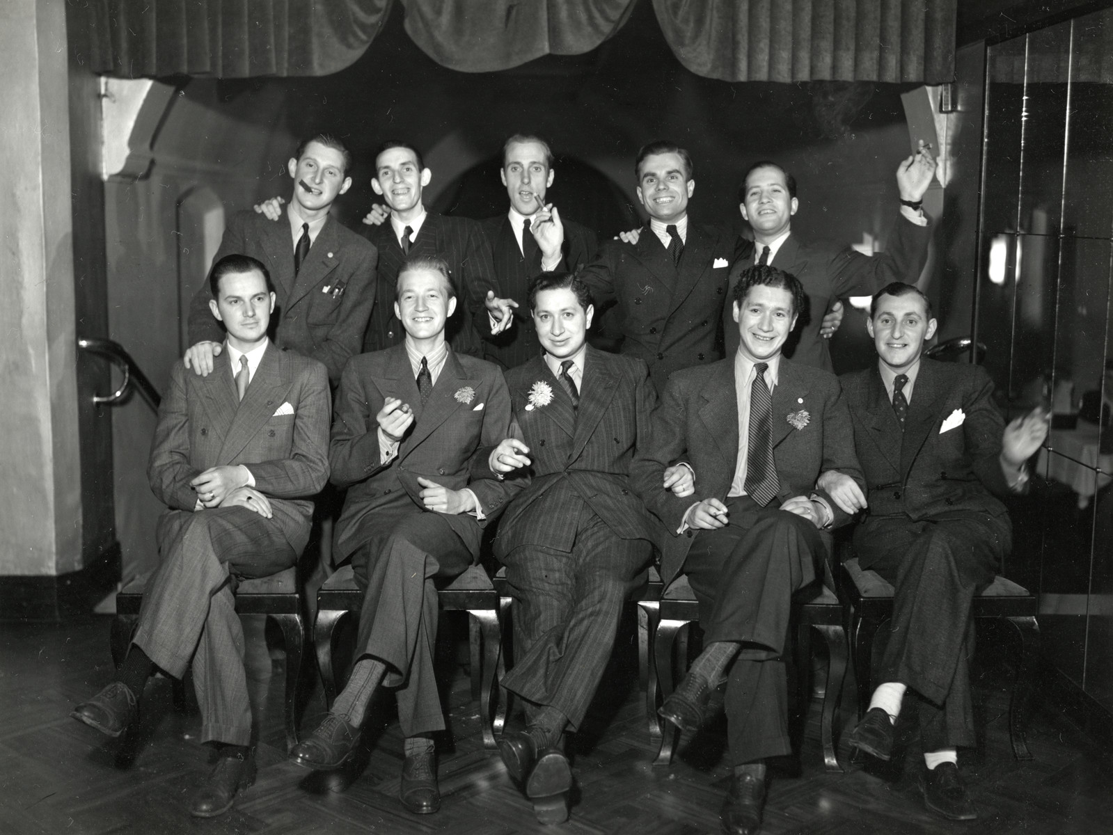 Group portrait of the members of the Judiska Ungdon, the Jewish social club in Malmo.  Elias Feigen is pictured in the front center.  His brother Bertil is to his right.  Hans Silver is seated on the far right.  Lennard Silwert is standing on the left.