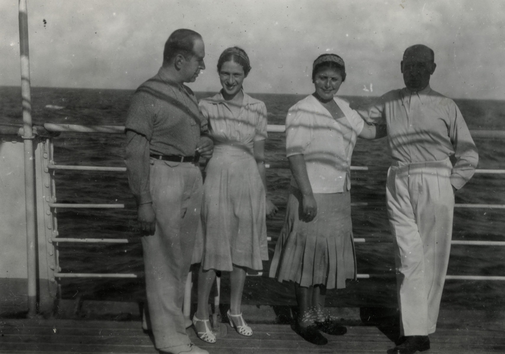 Refugees pose on the deck of a ship headed for Haita.  On the left are Herta and Walter Meinberg.