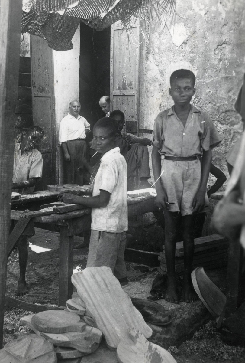 Haitian children work in Walter Meinberg's factory.