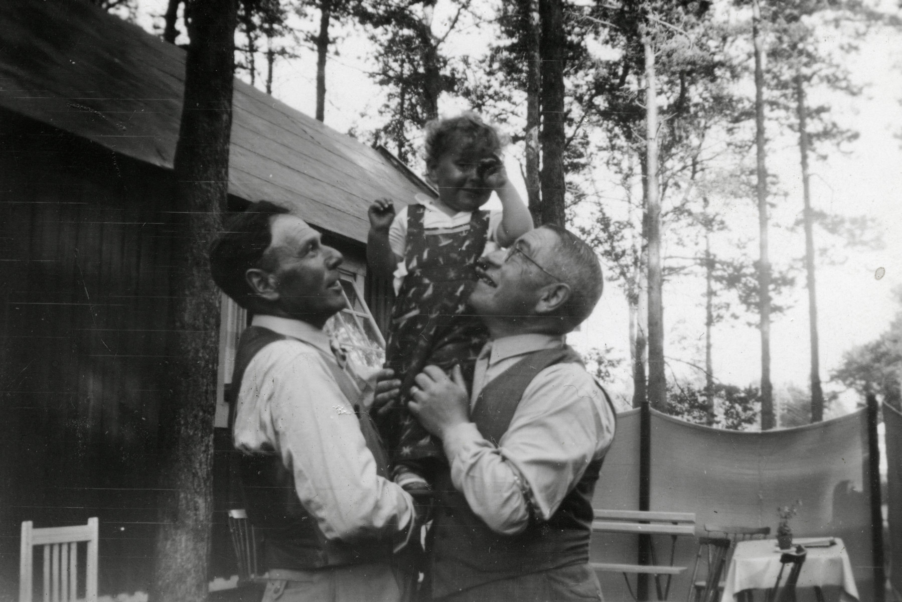 A Swedish Jewish family relaxes in its summer home.  Pictured are David Newmann, Harriet Feigen and Moses Feigen.