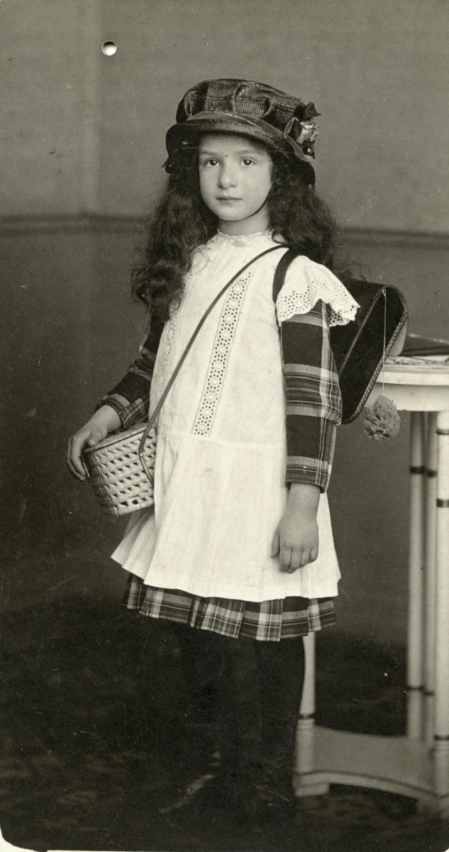 Herta Mayer poses with her book bag on her first day of school.