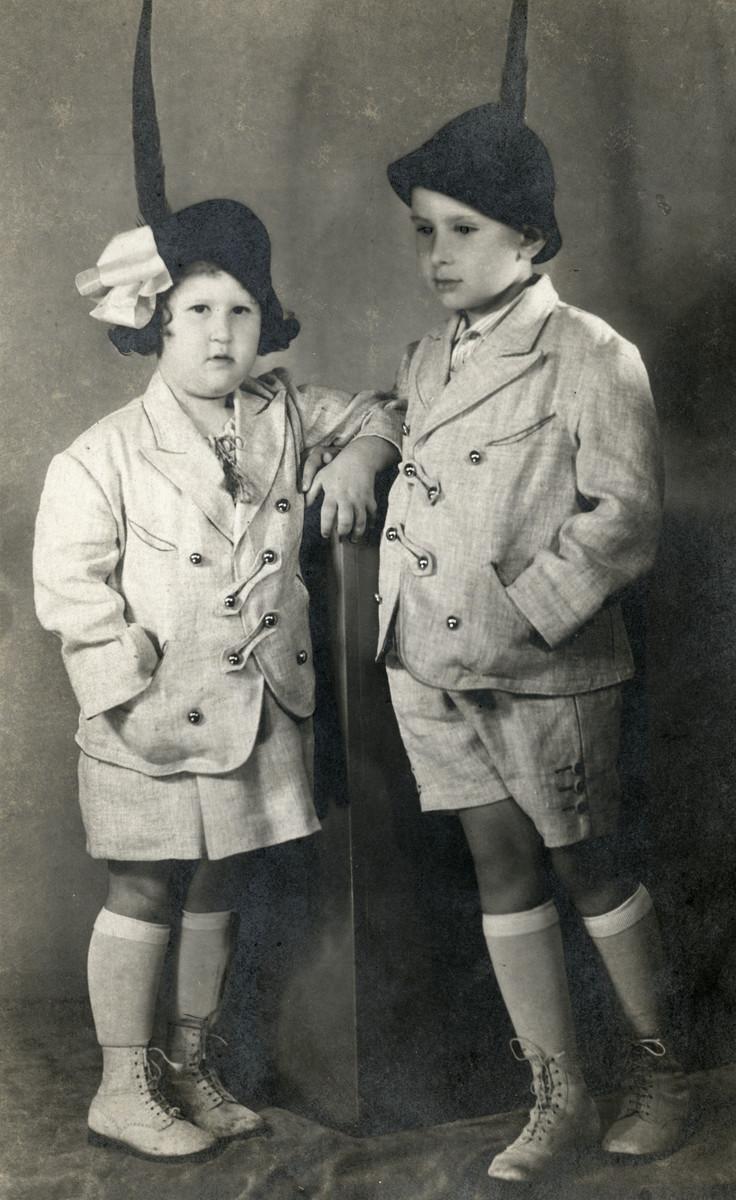 Studio portrait of Imre and Judit Frenkel wearing Alpine hats.
