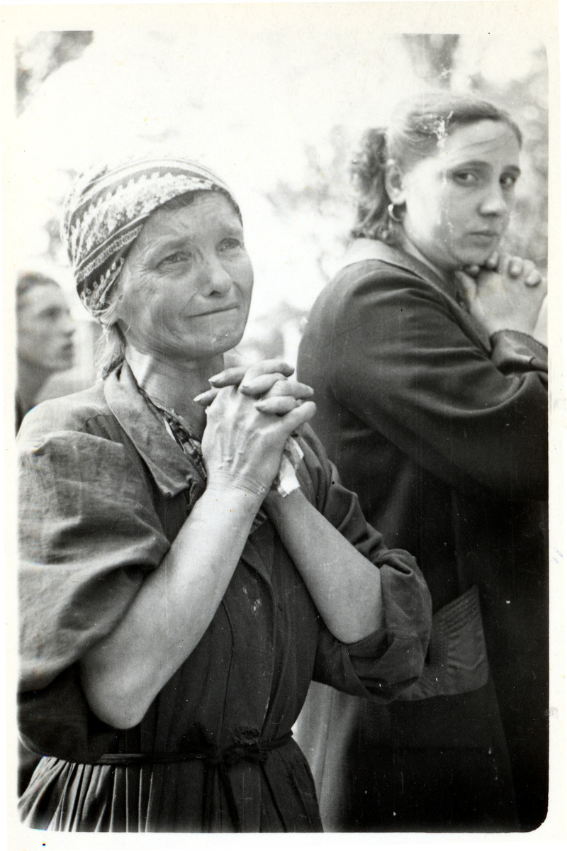 Close-up portrait of a praying Polish woman in besieged Warsaw.