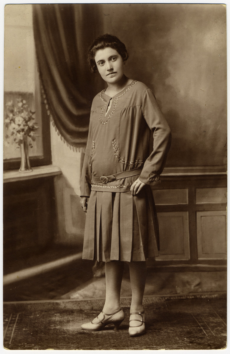 Studio portrait of R. Revinska, a sister of Louis Revinsky in a home in Eisiskes.