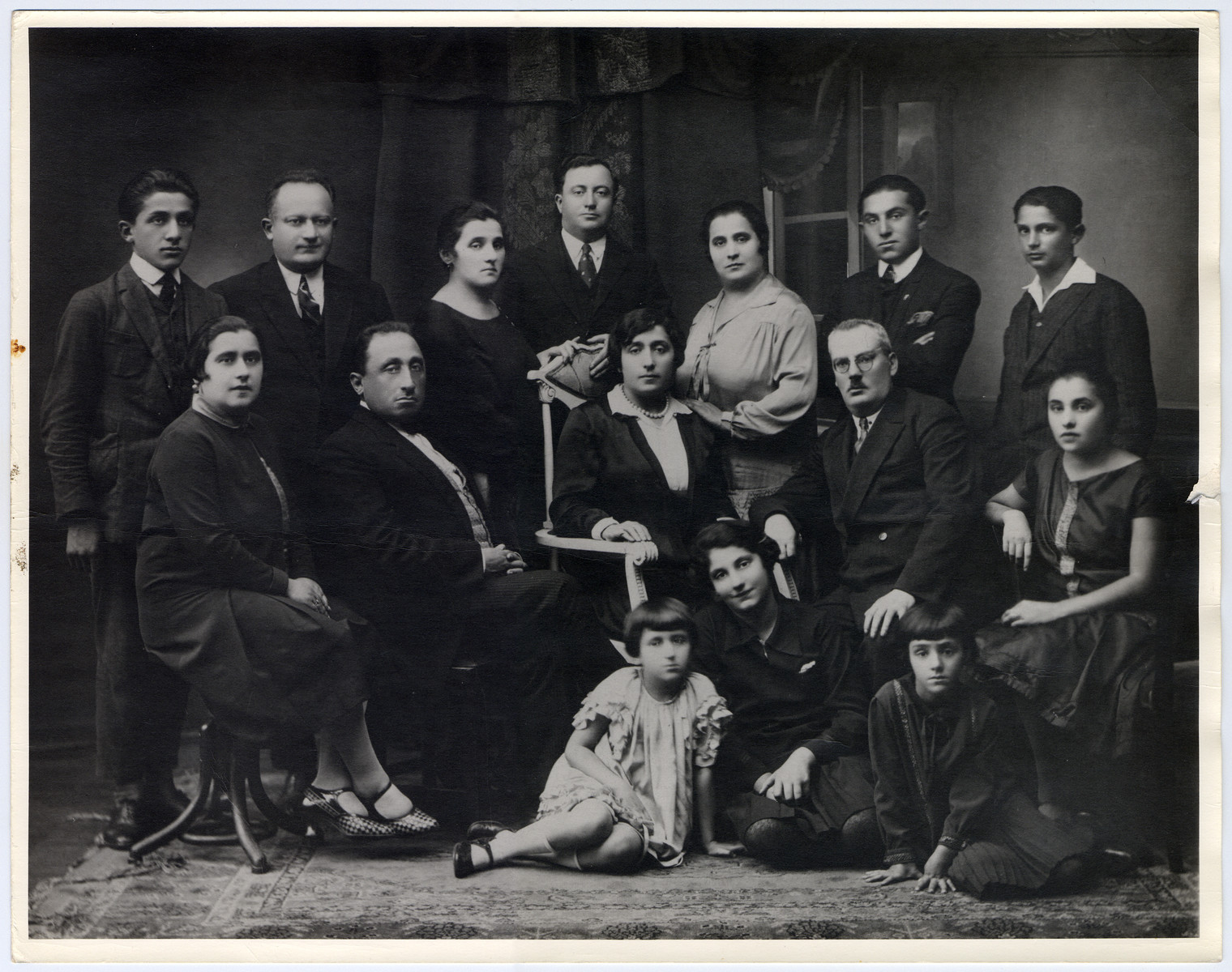 Group portrait of the Remz and Wolf families in Eisiskes.  Pictured are Gertrude (nee Remz), Louis and Frances Wolf (front, left), and Gertrude's siblings and their spouses Rifka and Zalman Rewin, Hershel and Stichel Remz and their children, Lolke, Olla (front, right), Gabke and Israel Remz and Marasna and Lazer Alpern and their children, Isaac and Zina.