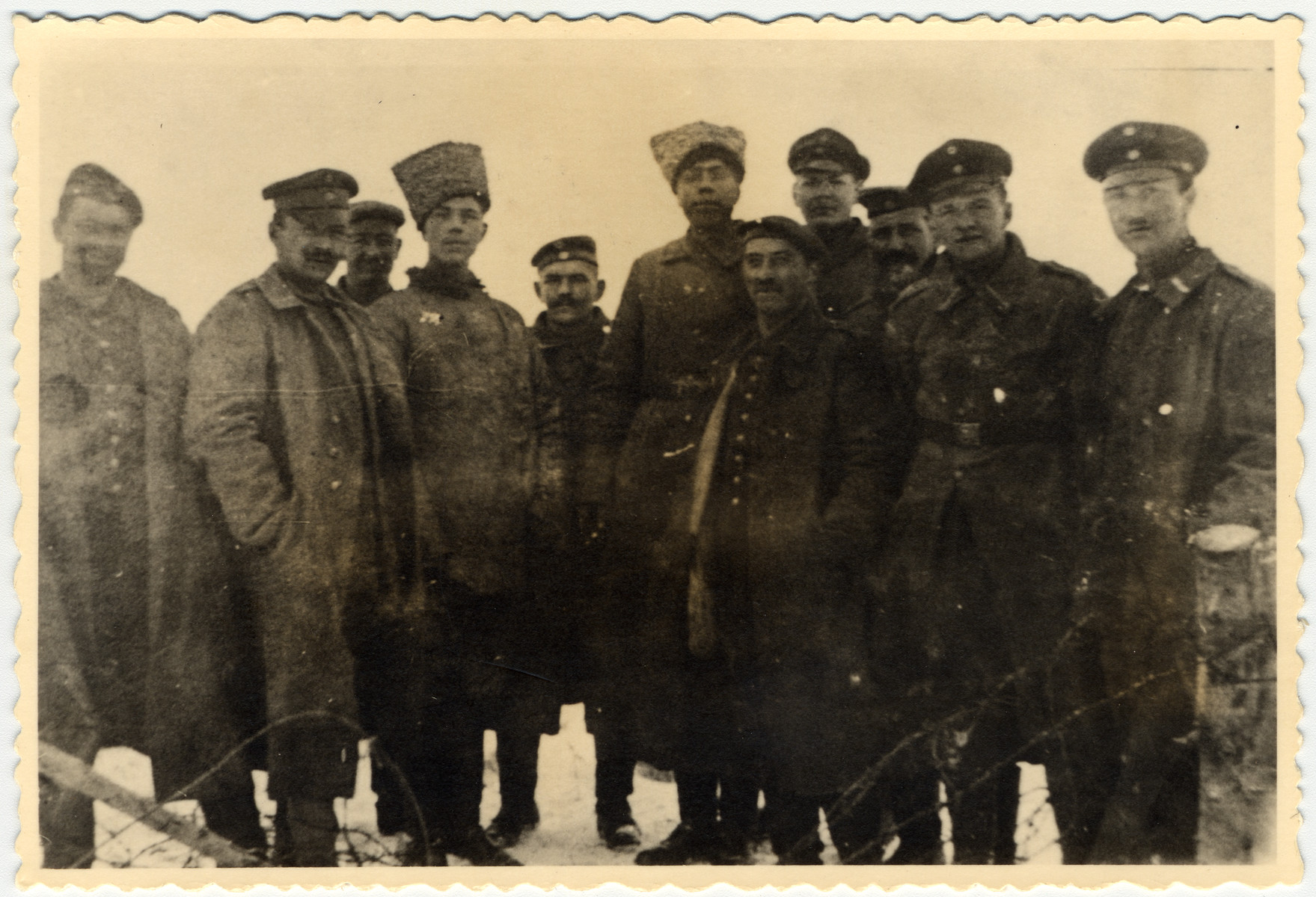 German and Russian soldiers pose together after the end of hostilities on the eastern front during World War I.  Among those pictured is Erwin Heilbronner (far right).