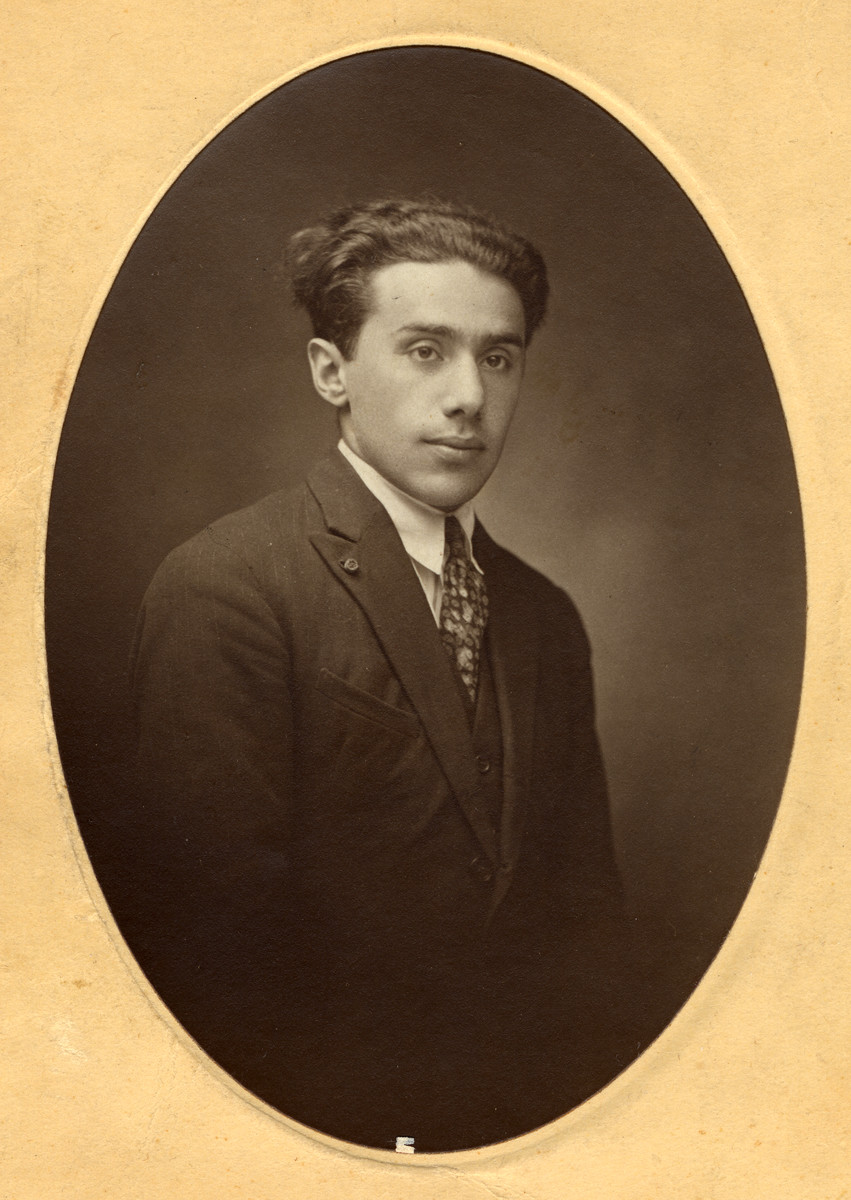 Studio portrait of Rufka (Robert) Remz, a young engineer in Grenoble, France who was born in Eisiskes.  He was the oldest son of Hershel and Stichel Remz and a cousin of the donor's mother.