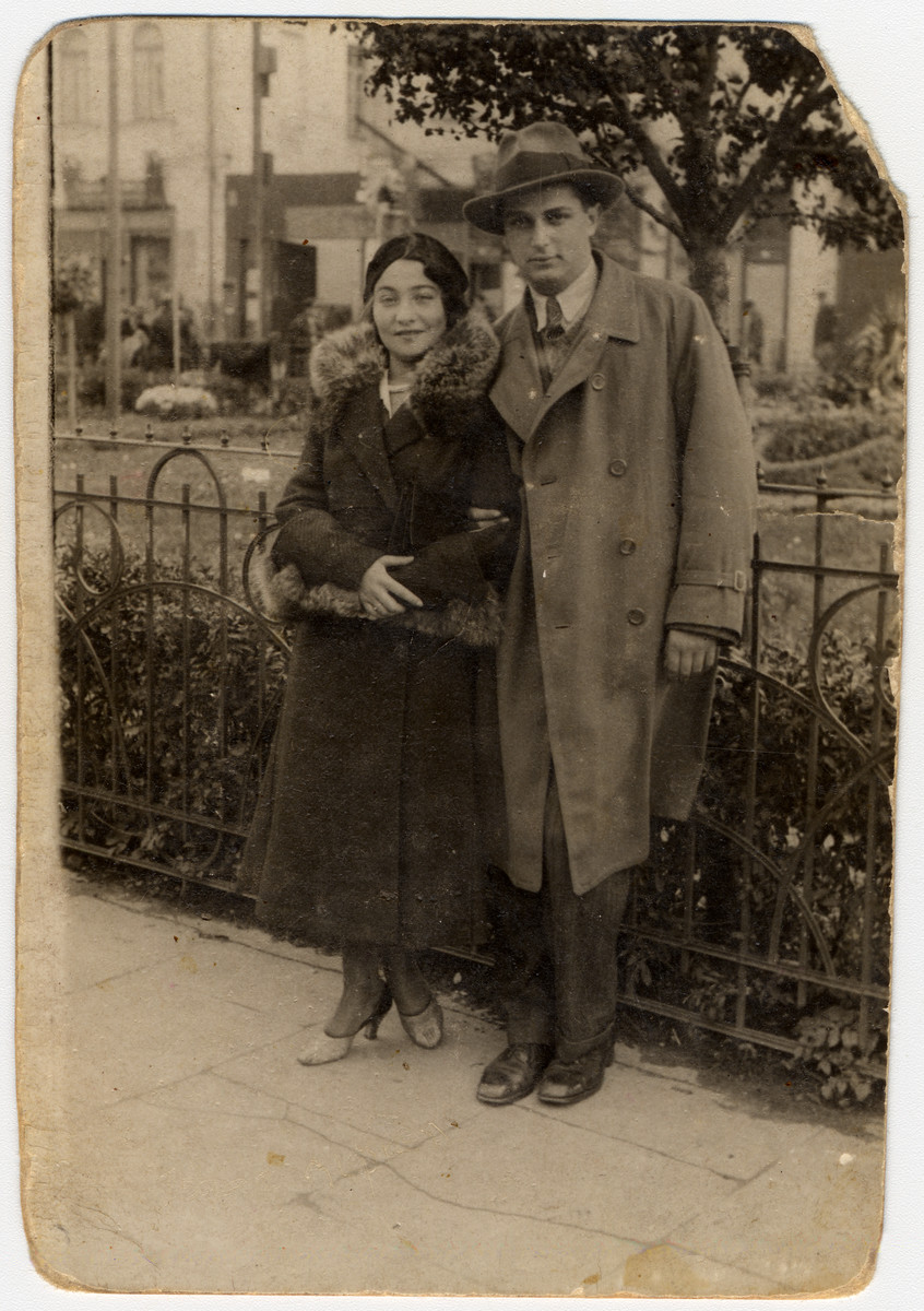 Portrait of a young couple standing on a street in either Eisiskes or Vilna.  Pictured is Izik Alpern.