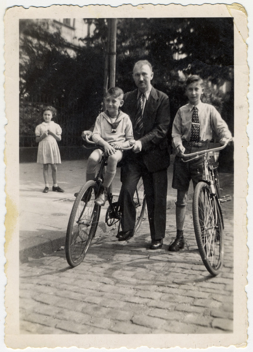 A German-Jewish father takes his two sons for a bicycle ride.  Pictured from left to right are Werner, Erwin and Kurt Heilbronner.