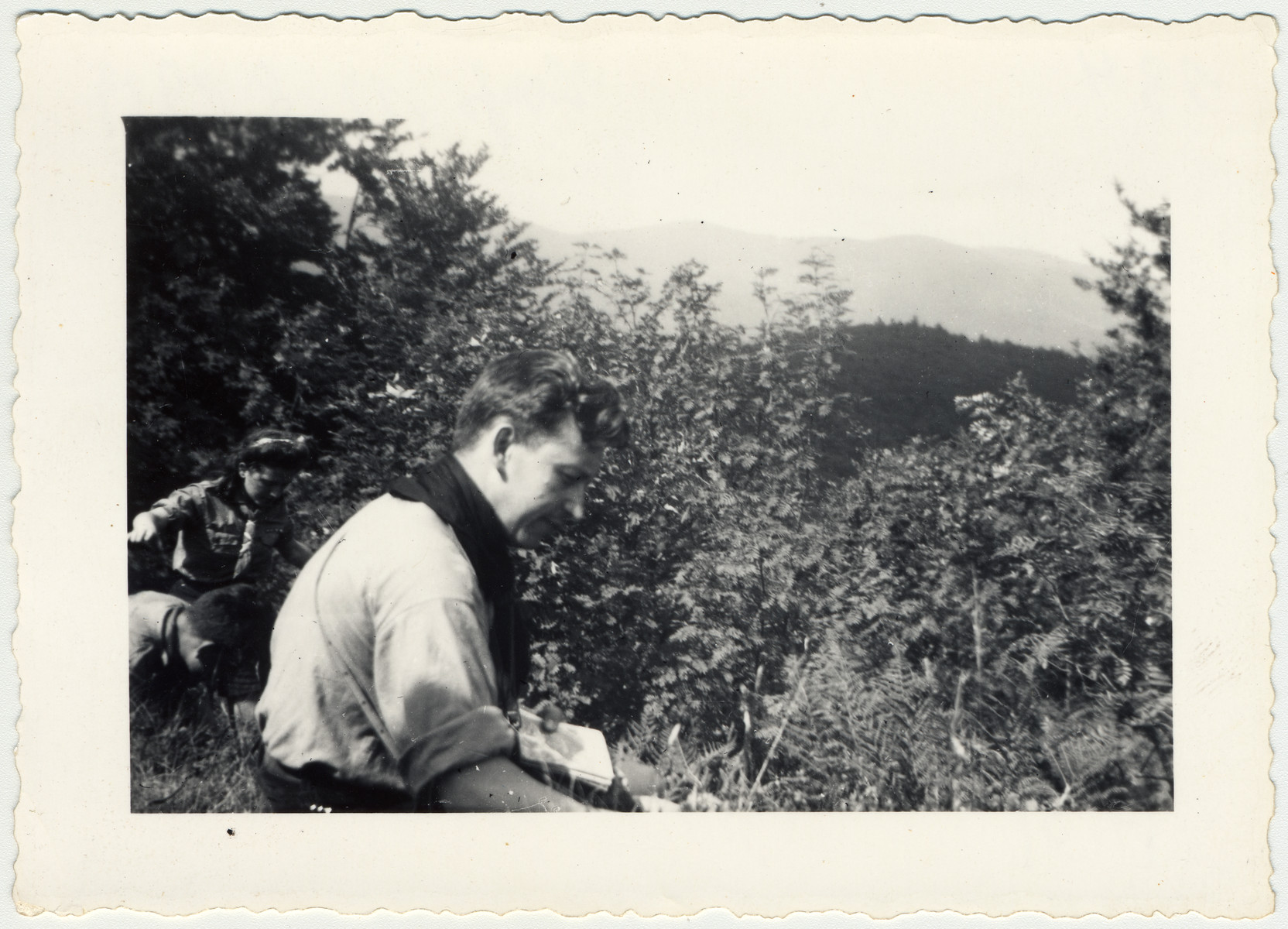 Aryeh Gelbard, a member of the Zionist movement, picks wild berries off the bushes.