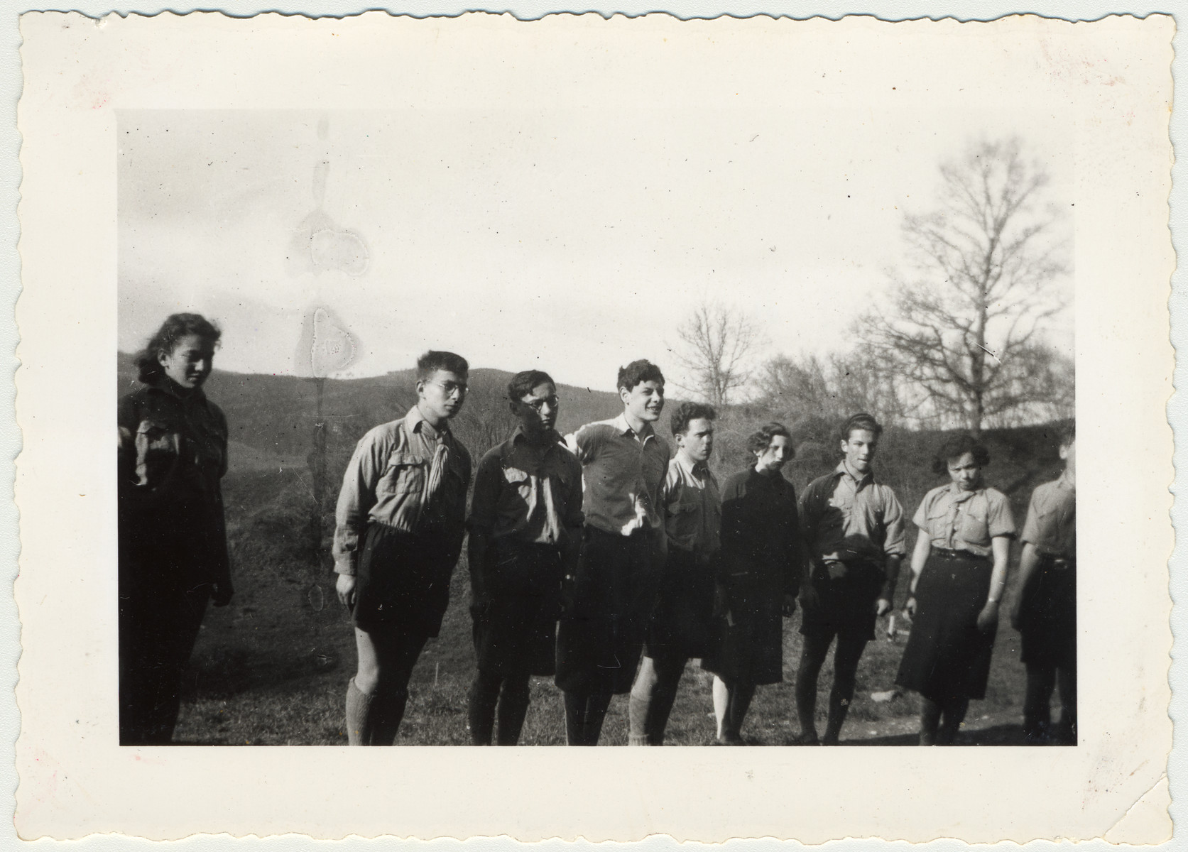 Zionist youth assemble for roll call at their summer camp.  Pictured are Lony Browar, Henry Felsenstein, Leo, Aby, Teddy Browar, Gerda Jakubow, Pierrot, Lily Bornstein, and Bruno Lewison.